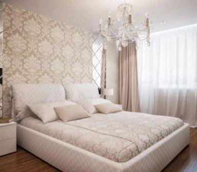 Спальня в бело бежевом интерьере