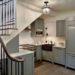 Как обустроить пространство под лестницей в доме